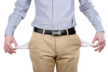 Man showing his empty pockets isolated on white photo