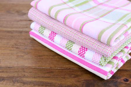 dishtowel: Kitchen towels on wooden background