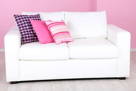 White sofa in room on pink background photo