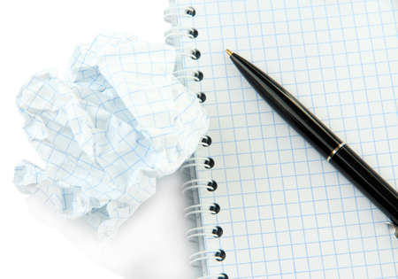 Notebook and pen with crumpled paper ball close up photo