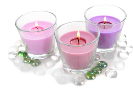 candlelit: Beautiful colorful candles isolated on white