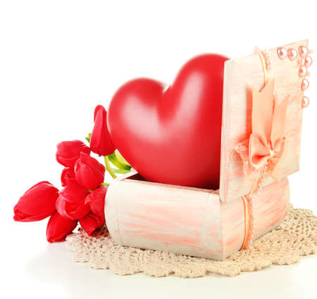 Heart in wooden casket, isolated  on white background photo
