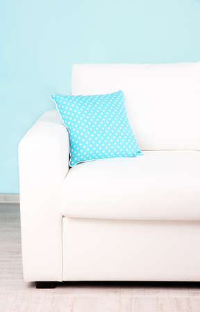 White sofa close-up in room on blue background Stock Photo