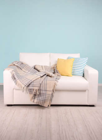 leather sofa: White sofa in room on blue background