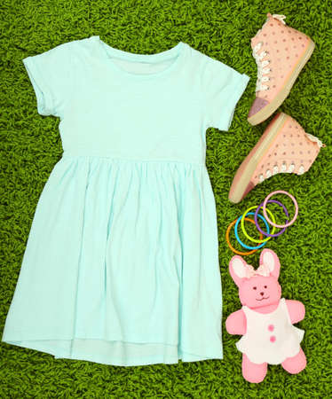 green carpet: Beautiful dress and gumshoes for little girl on green carpet