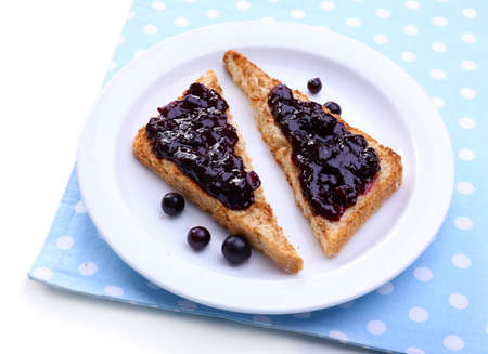 Delicious toast with jam on plate close-up Banco de Imagens