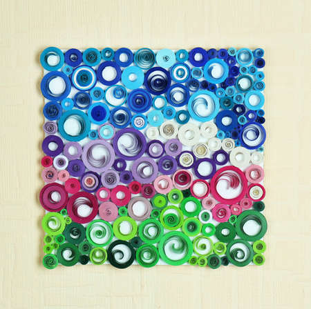 quilled shapes: Abstract colorful picture on wall Stock Photo