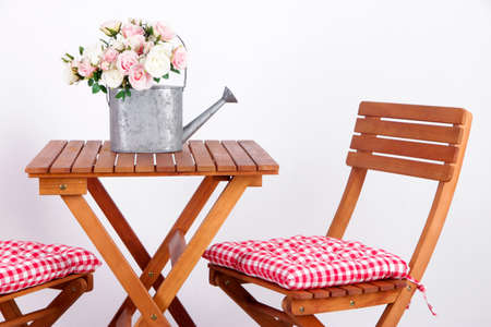 Garden chairs and table on white