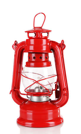 Red kerosene lamp isolated on white photo