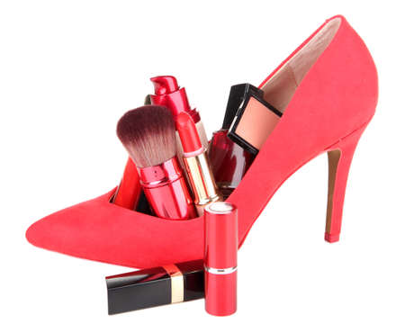 Beautiful red female shoe with cosmetics, isolated on white photo
