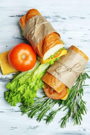 breakfast sandwich: Fresh and tasty sandwich on wooden