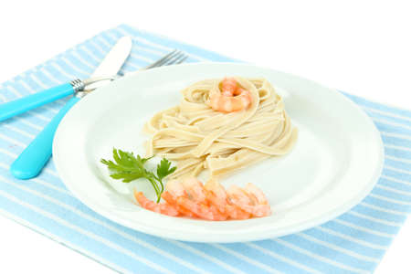 Pasta with shrimps on white plate, isolated on white photo