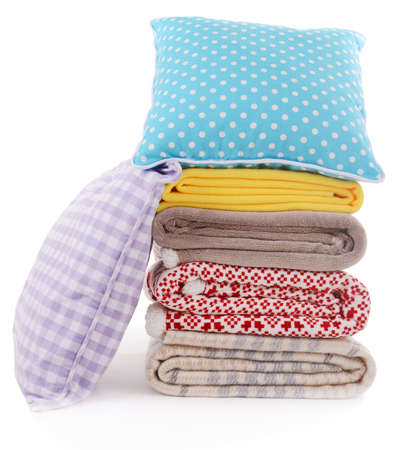 Colorful pillows and plaids isolated on white photo