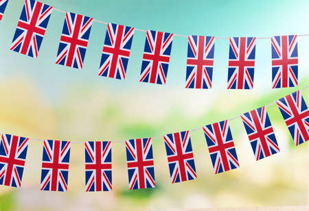 Garland of flags on bright background photo