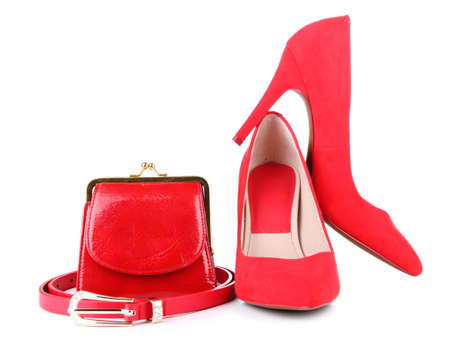 Beautiful red female shoes, purse and belt, isolated on white photo
