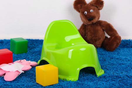 Green potty on home interior background photo