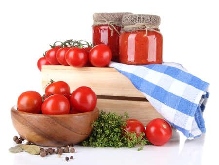 Tasty tomato sauce and fresh tomatoes, isolated on white photo