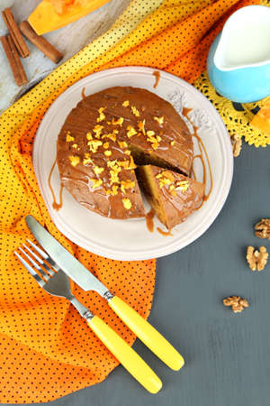 pone: Delicious pumpkin pie on plate on wooden table close-up Stock Photo