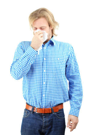 Sneezing young man isolated on white Stock Photo - 26412254