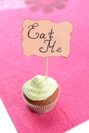 Tasty cupcake with butter cream,on color napkin,  isolated on white photo
