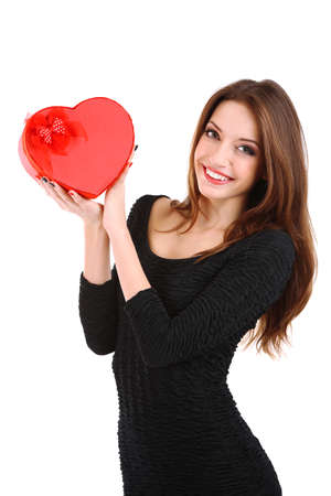 Attractive woman with gift box in form of heart, isolated on white photo