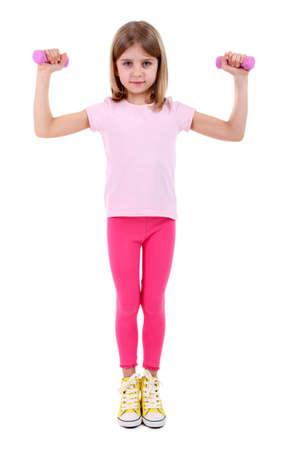 Beautiful little girl doing exercises isolated on white photo