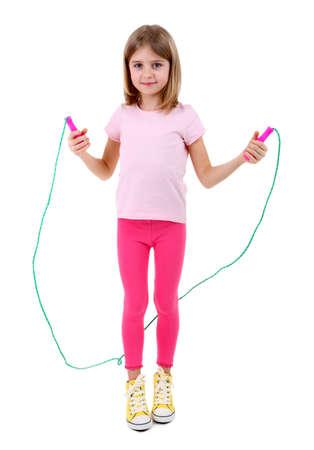 Beautiful little girl doing exercises isolated on white Stock Photo