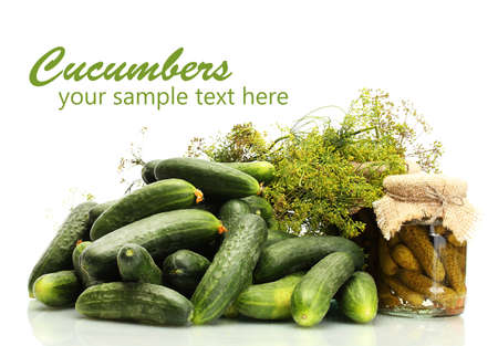 Fresh cucumbers, pickles and dill  isolated on white photo