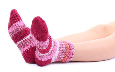 Female legs in colorful socks, isolated on white