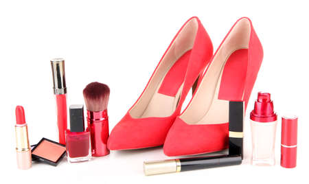 Beautiful red female shoes with cosmetics, isolated on white photo