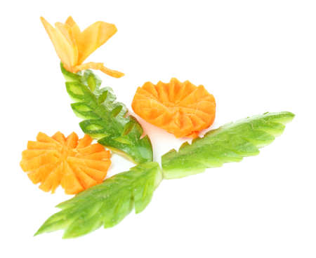 Carving vegetable patterns of flowers and leafs isolated on white photo
