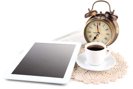 Tablet, newspaper, cup of coffee and alarm clock, isolated on white photo