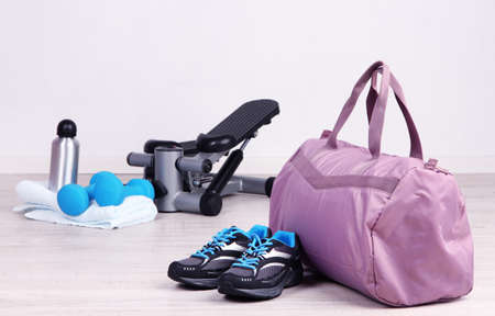 Sports bag with sports equipment in gymnasium Reklamní fotografie - 25706339