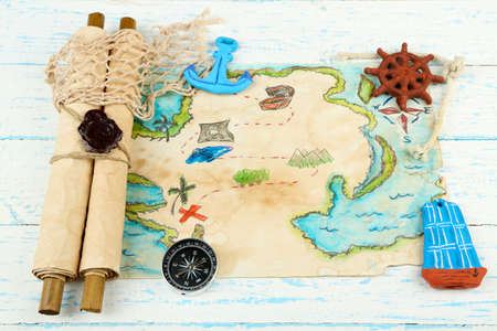 Treasure map with sea accessories, on wooden background photo