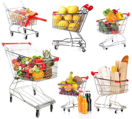 Trolleys with different products isolated on white photo