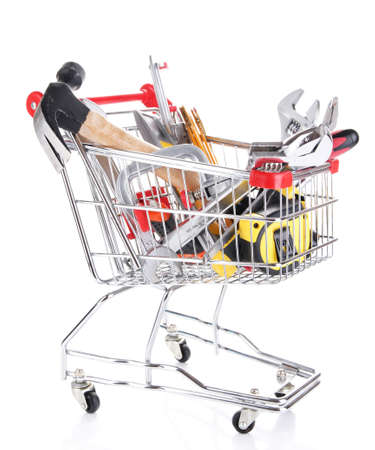 Construction tools in shopping cart isolated on white photo