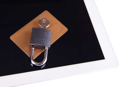 unblock: Credit card with lock and tablet close up Stock Photo