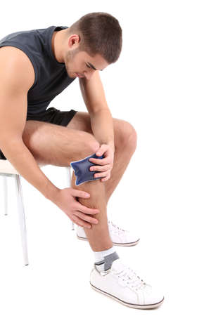 pain: Young man with knee pain, isolated on white