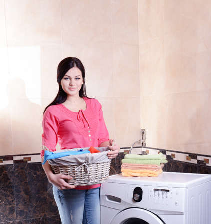 Beautiful young woman erases in house photo