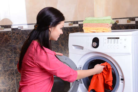bright housekeeping: Beautiful young woman erases in house