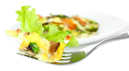Omelet with mushrooms isolated on white photo