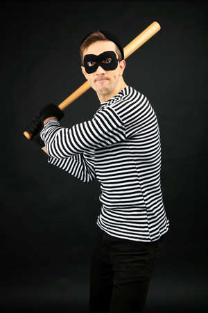 Thief isolated on black Stock Photo - 26412933