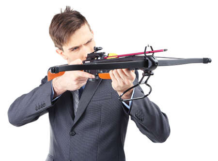 arbalest: Young businessman with crossbow, isolated on white Stock Photo
