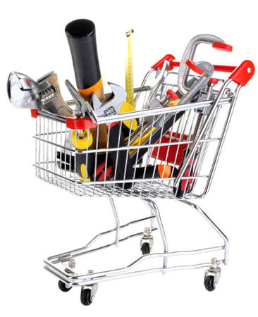 Construction tools in shopping cart isolated on white Stock Photo - 25752311
