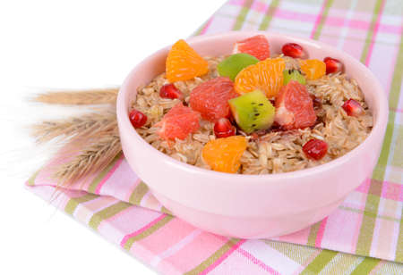 meatless: Delicious oatmeal with fruit in bowl on table close-up