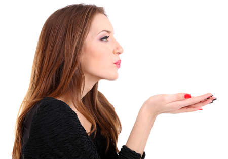 Attractive woman blowing kiss, isolated on white photo