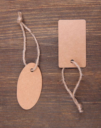 Set of tags  on color wooden background photo