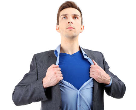 apart: Young business man tearing apart his shirt revealing  superhero suit, isolated on white