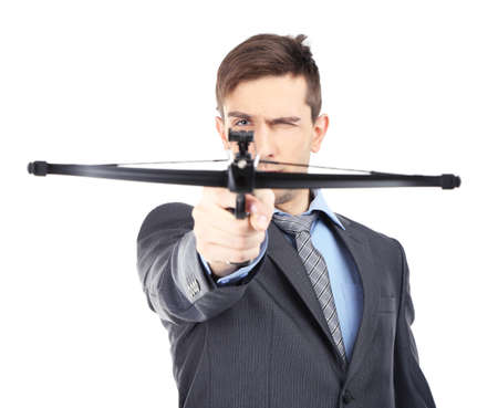 Young businessman with crossbow, isolated on white photo