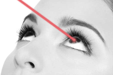 opthalmology: Woman eye with laser correction in shades of grey Stock Photo